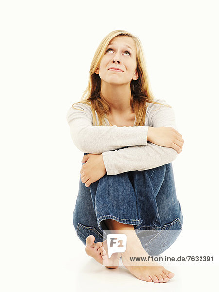Woman sitting with bent knees  dreamy