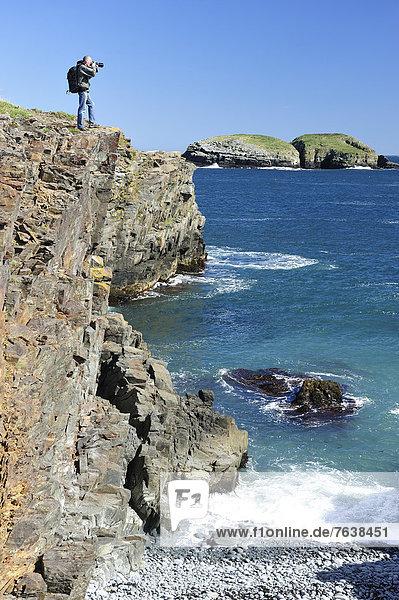 Man,  photographer,  taking pictures,  Coastline,  Elliston,  Newfoundland,  Canada,  coast,  rocky,  cliff