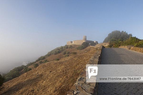 Algarve  Aljezur  fortress  fog  Portugal  Europe  street