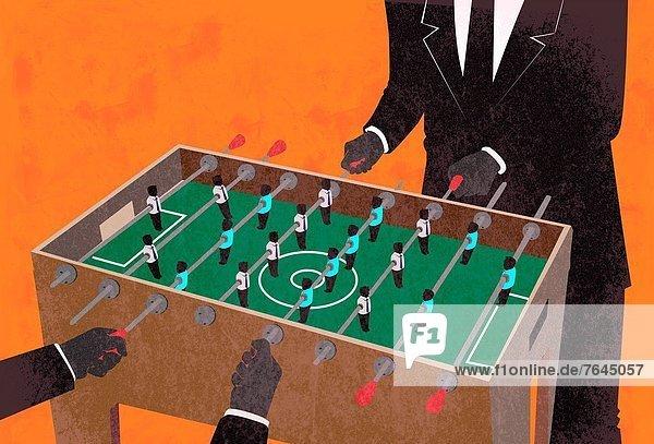 Fotografie Geschäftsmann 2 Tischkicker spielen