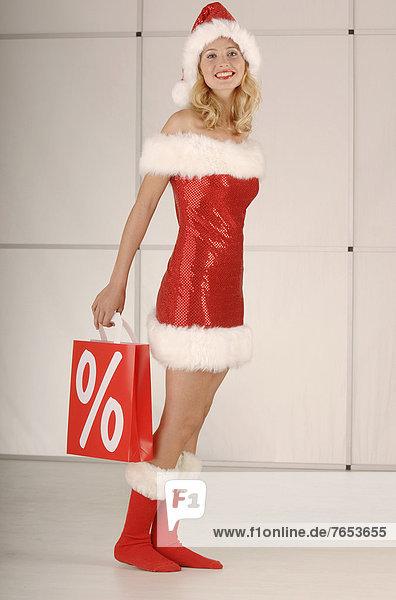 Hingebung Tasche halten Zeichen Weihnachten kaufen Prozentzeichen Teenagerin Signal