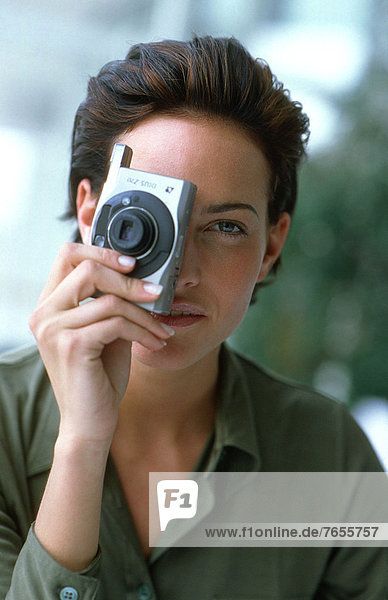 Frau mit Photoapparat