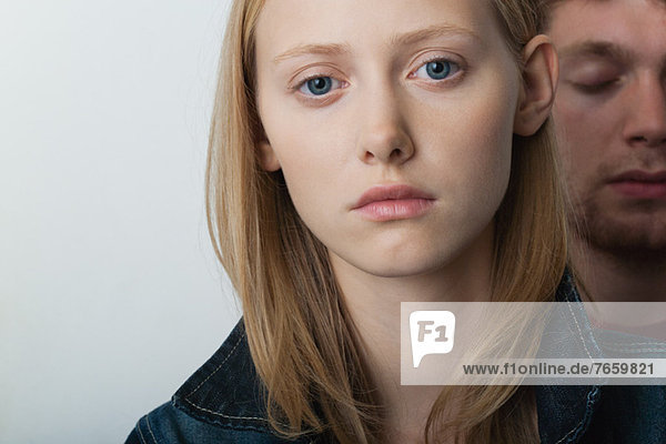 Young woman with unhappy expression  portrait