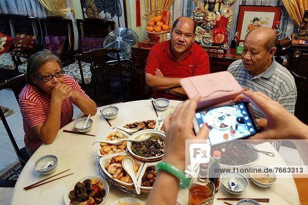 A typical Chinese New Year Eve family gathering dinner in Kuching  Sarawak  Malaysia.