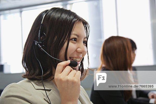 Geschäftsfrau  Business Frau mit Headset