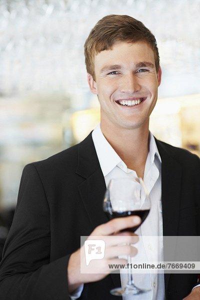 Portrait of man drinking wine