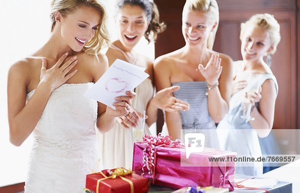 Bride and bridesmaids unpacking gifts