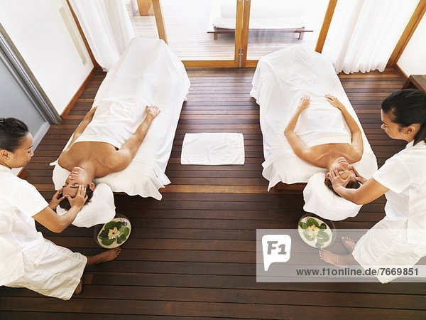 Couple getting massage in spa