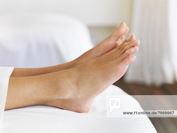 Bare feet of woman in spa