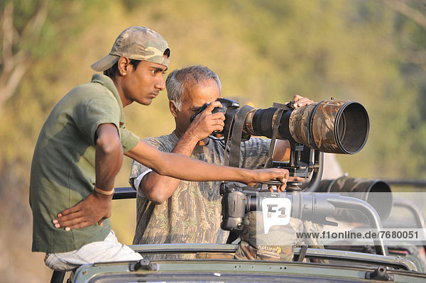 India  Uttarakhand state  Corbett National Park  off road vehicle with photographers