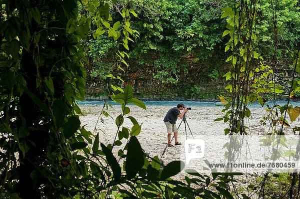 Dominican Republic  National Park Sierra Martin Garcia  photographer in rainforest