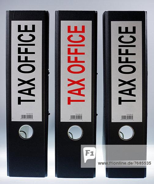 'Three file folders labeled ''tax office'''