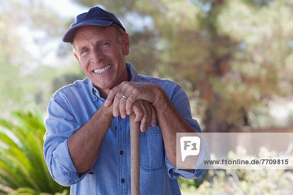 Older man gardening outdoors