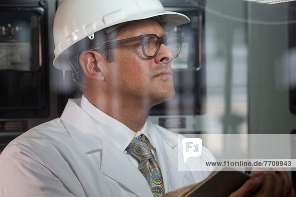 Industrial worker at switch board
