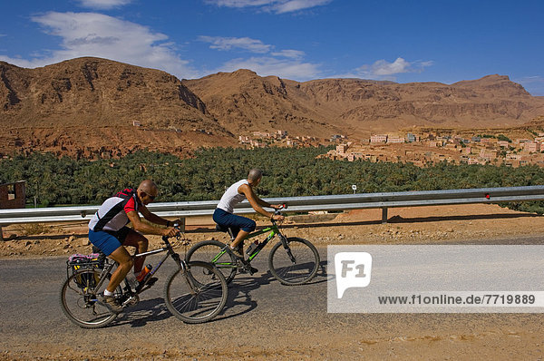 Cyclists Along Route Of 1000 Kasbahs