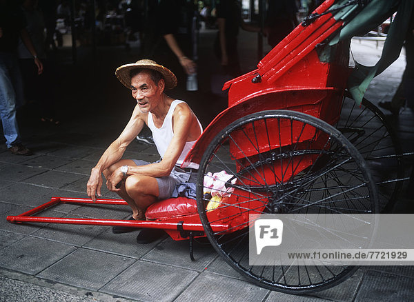 Elderly Man With His Cart