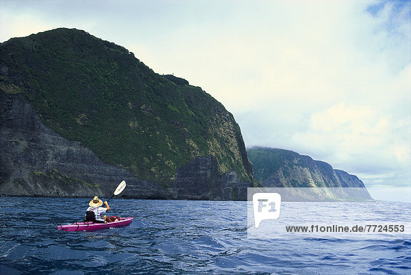 Hawaii  Big Island  North Shore  Along Coastline  Person Kayaking B1534. For Editorial Use Only.