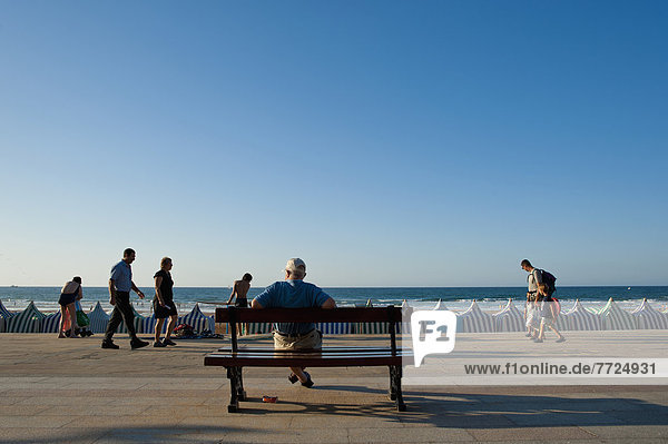 Man Watching People Passing By  Zarautz  Basque Country  Spain