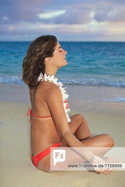 Hawaii  Oahu  Kailua  Lanikai  Young Woman Meditating On Beach.