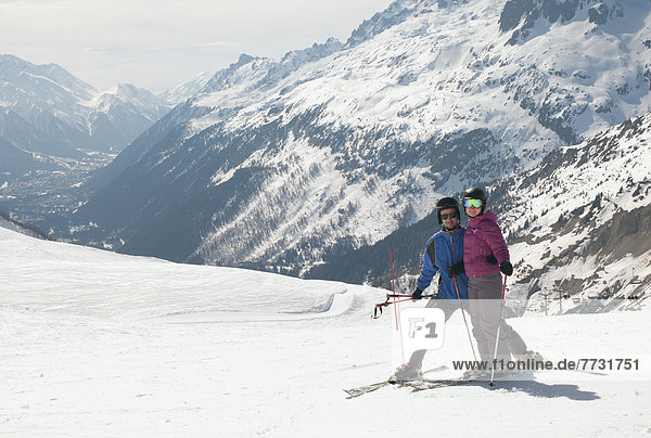 A Couple Skiing In The French Alps  Chaminox-Mont-Blanc Rhone-Alpes France