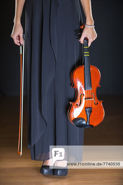 Young woman holding violin
