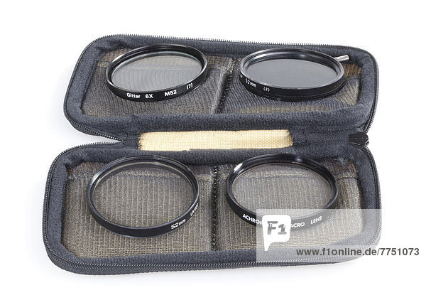 Case with different filters for a camera lens