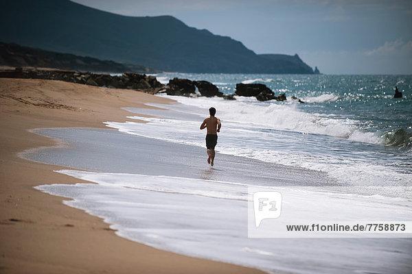 Mann  Strand  rennen  jung