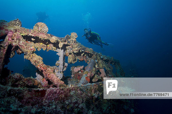 'Scuba diver at the wreck of the ''Kyokuzan Maru''  Japanese freighter sunk in 1944'
