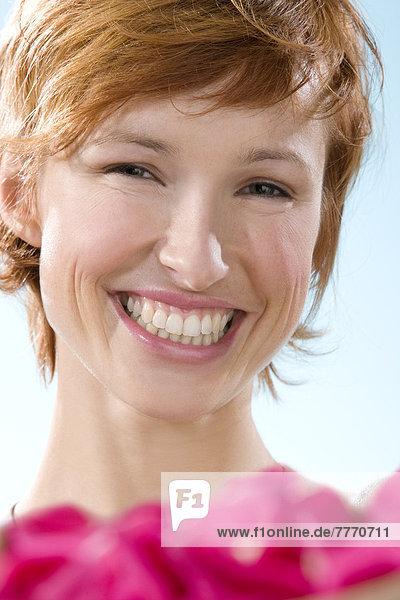 Portrait of young smiling woman  flower petals