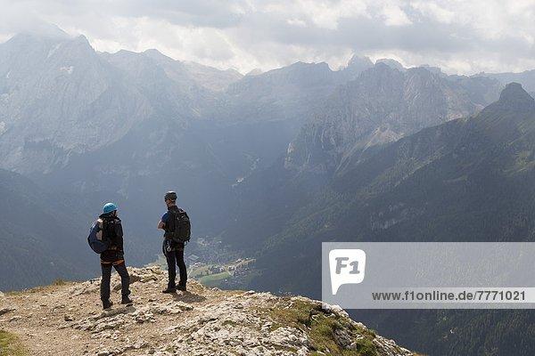 Climbers on the Sassolungo mountains in the Dolomites near Canazei  Italy  Europe