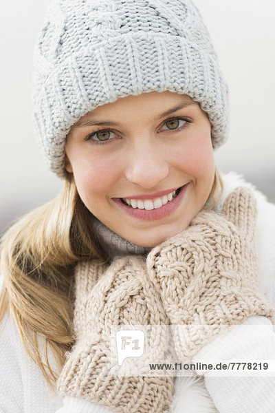 Portrait of young woman in winter clothing