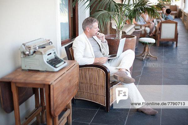 Casual businessman using laptop