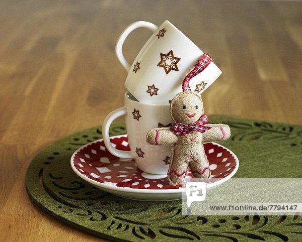 Stapel Mann Becher klein Weihnachten belegt Lebkuchen 2 Untertasse