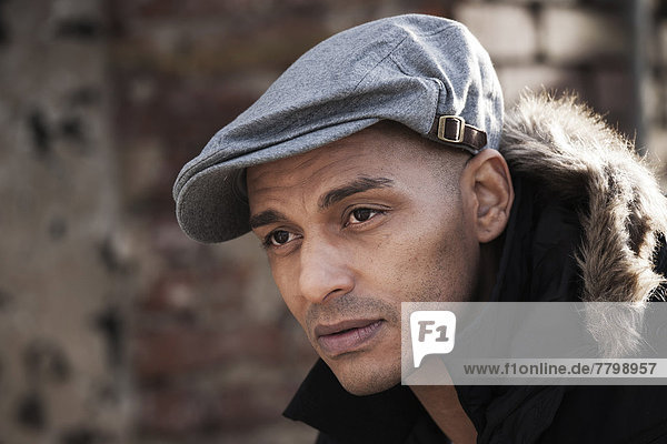 Portrait of Man Outdoors Wearing a Cap  Mannheim  Baden-Wurttemberg  Germany