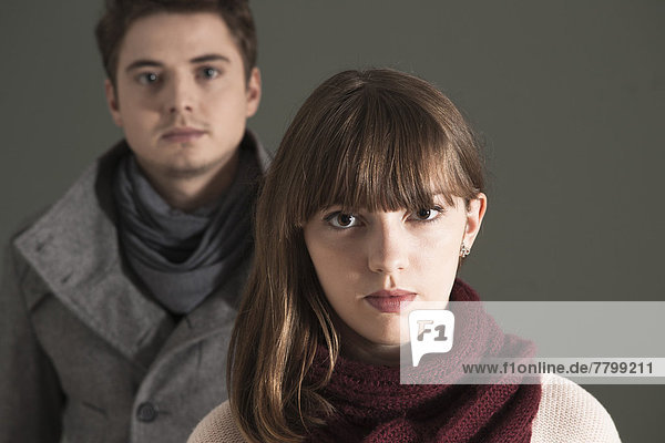 Close-up  Head and Shoulder Portrait of Young Couple Looking at Camera  Studio Shot on Grey Background