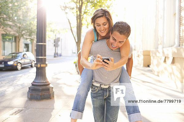 Couple Outdoors  Man Piggybacking Woman  Portland  Oregon  USA