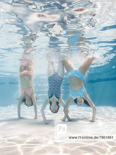 USA  Utah  Orem  Women doing handstand under water