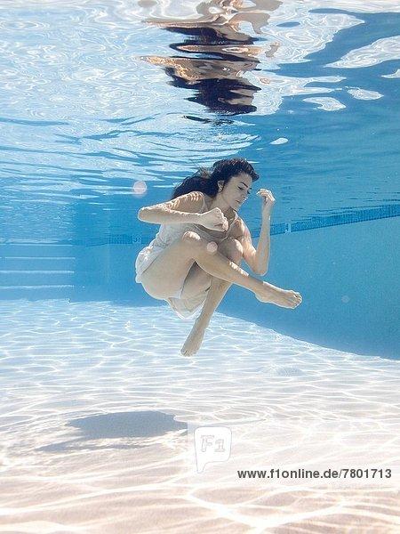 USA  Utah  Orem  Young woman in pool ballet dancing