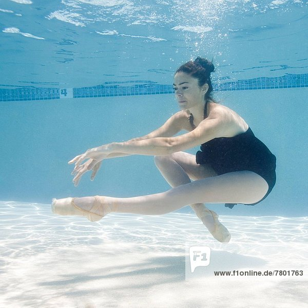 USA  Utah  Orem  Female ballet dancer under water