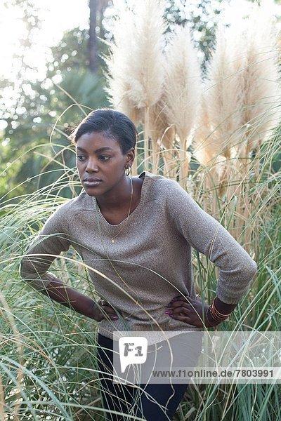 Black woman posing as a model.