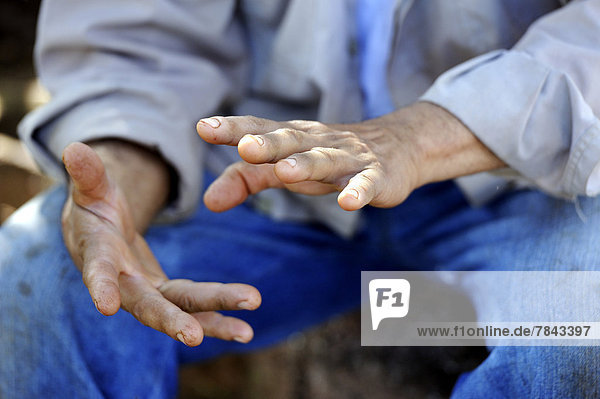Man  peasant leader in Paraguay  gesturing with his hands during a discussion