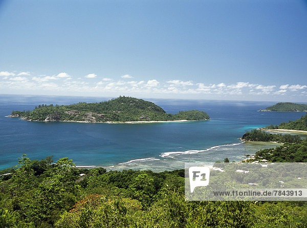 View from a hill on Mahe Island towards an island off the coast