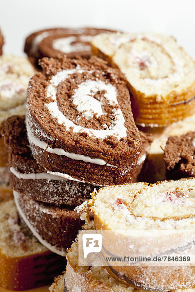 Slices of chocolate and raspberry roll sponge cake  close up