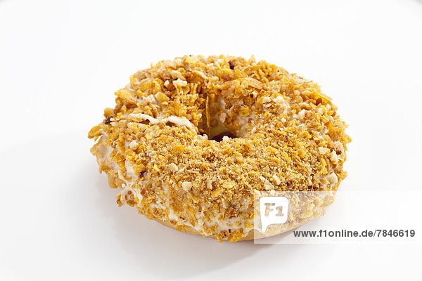 Doughnut topped with sprinkles on white background  close up