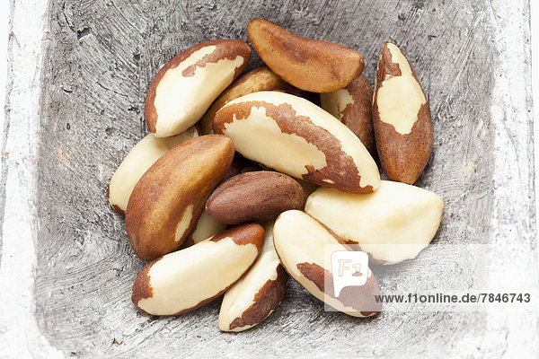 Brazil nuts in container  close up