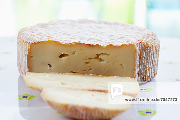 French soft cheese on chopping board  close up
