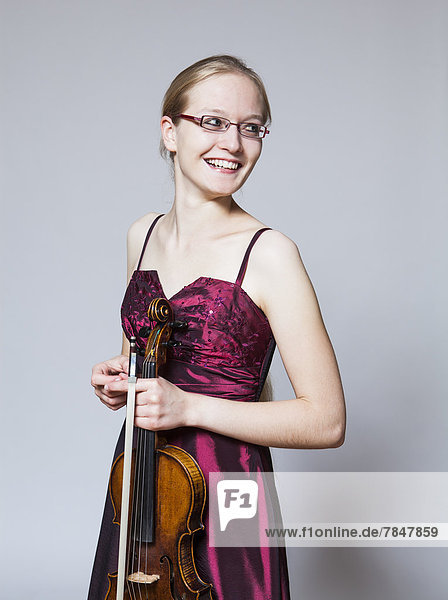 Teenage girl holding violin  close up