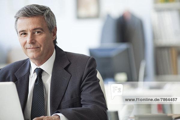 Mature businessman in office  portrait