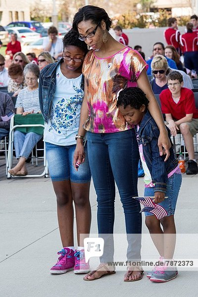 Warren  Michigan - A woman and children pray during the annual National Day of Prayer observance at city hall.