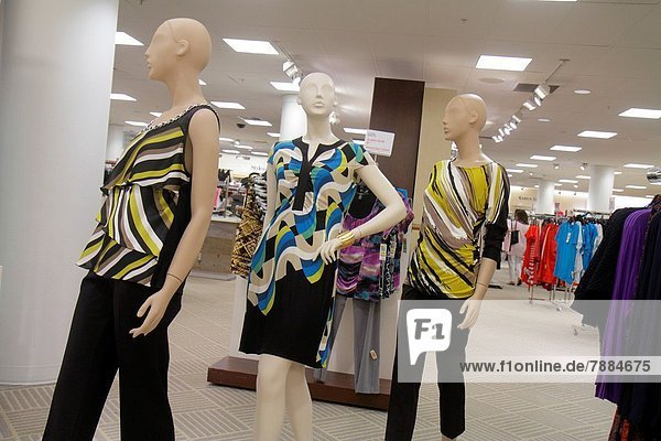 Florida  Miami  Dadeland Mall  shopping  for sale  Macy's  department store  interior  women's  clothing  fashion  mannequins  retail display  racks  blouses  dresses  female  woman .